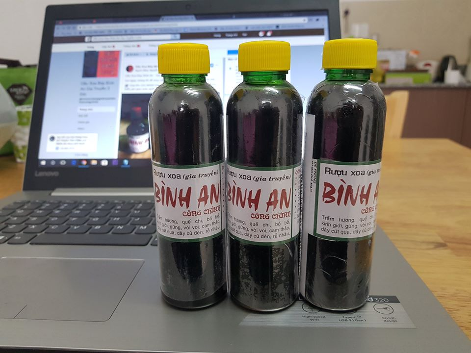 dầu xoa bóp bình an chai trung 02